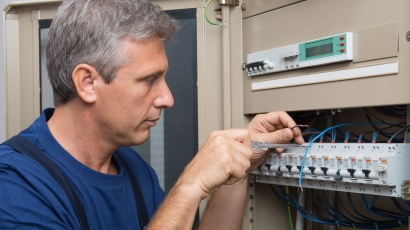 Repairman Fixing An Electric Switchboard Indoor
